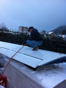 Steve deicing airplane prior to flight in December.